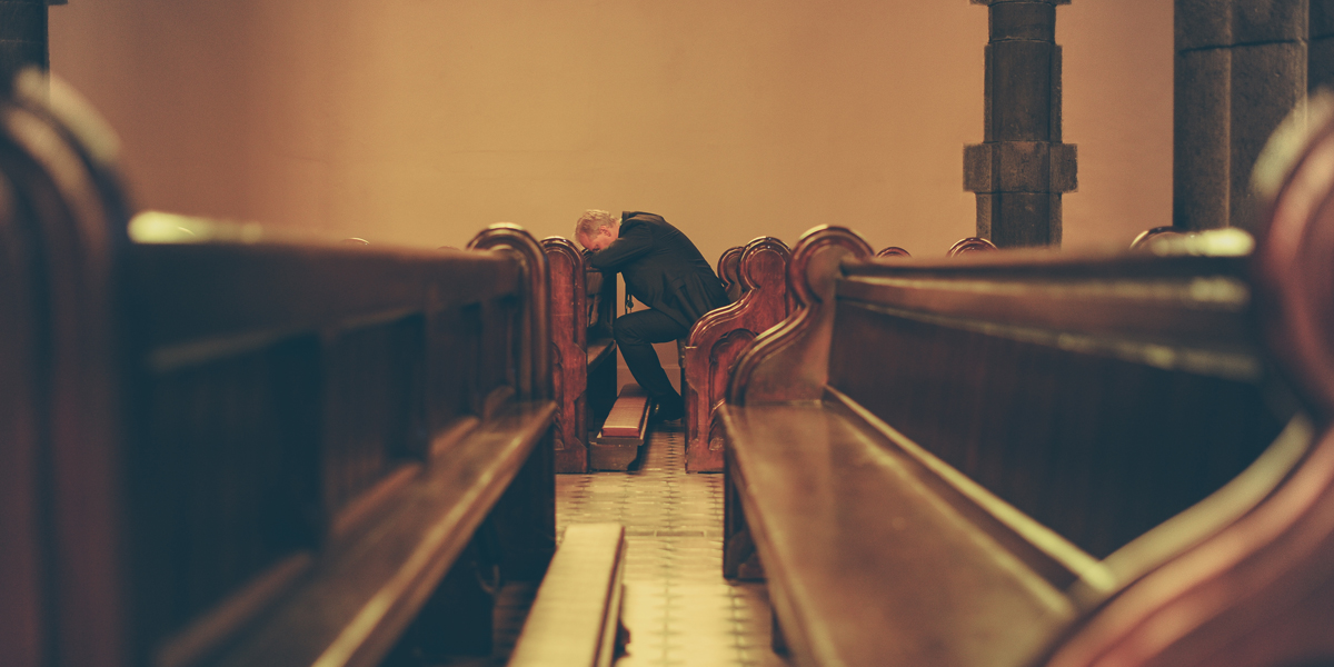 MAN,PRAYING,CHAPEL