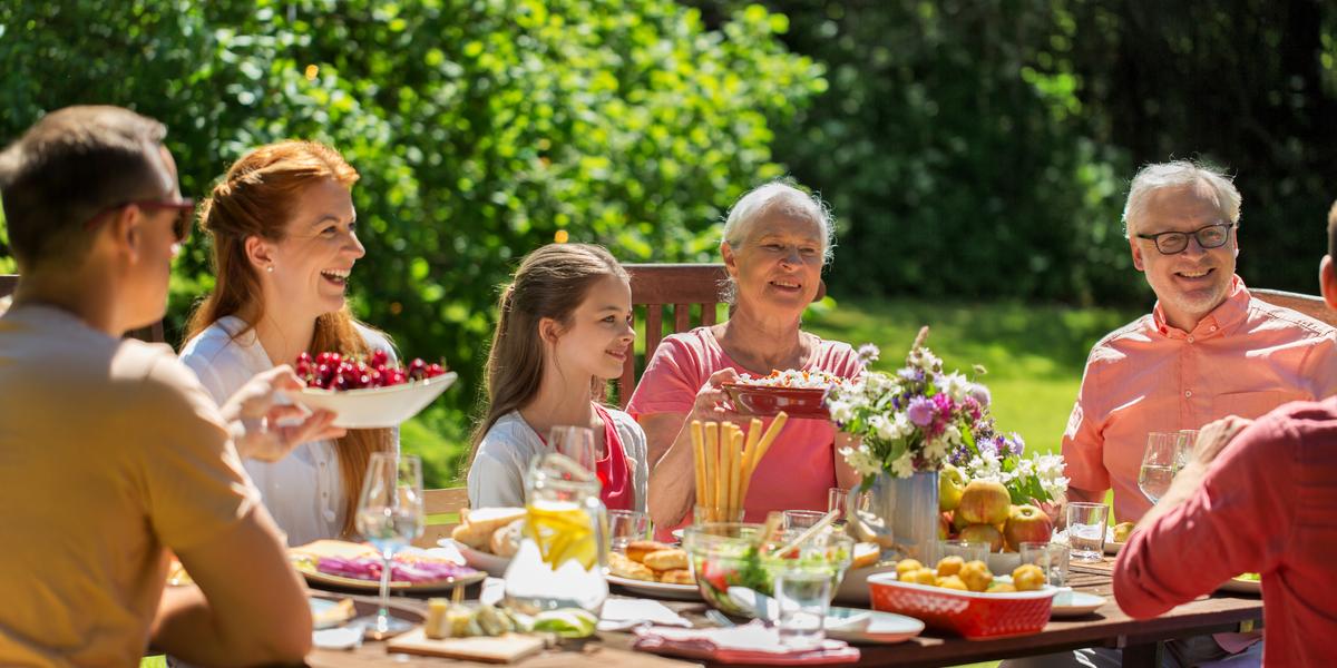 happy family having festive dinner or summer garden party